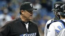 Toronto Blue Jays manager John Farrell, left, talks to players J.P. Arencibia and John McDonald after taking starting pitcher Kyle Drabek out of the game during the sixth inning against the Tampa Bay Rays in a baseball game Thursday, May 5, 2011 in St. Petersburg, Fla. The Rays defeated the Blue Jays 3-1. (Chris O'Meara/AP)