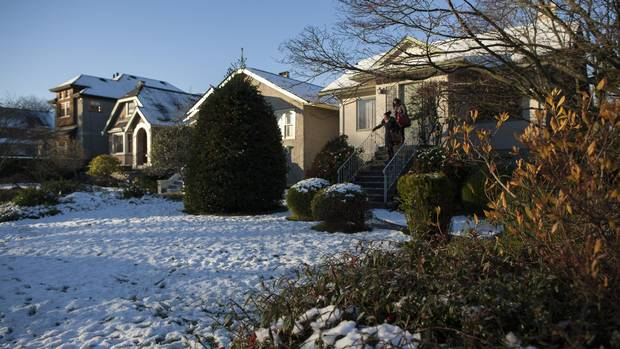 Linda Ren, right, and her mother, Sophie Li visit their home they were recently renting out in Vancouver, British Columbia, Wednesday, December 7, 2016. Rafal Gerszak/The Globe and Mail
