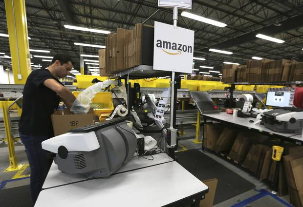 Products are packaged at Amazon fulfillment centre in Brampton, Ont., on July 21, 2017.