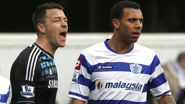 Queens Park Rangers' Anton Ferdinand is marked by Chelsea's John Terry before a corner kick during their FA Cup soccer match at Loftus Road in London in a January 28, 2012