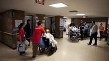 Patients and health-care workers wait for an elevator in the old Bridgepoint Hospital in Toronto in April, 2013. The Canadian Wait Time Alliance warns Canada's health-care system could be crippled by inefficiency and lack of transparency over the true extent of waiting times. (Matthew Sherwood For The Globe and Mail)