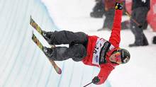 In this Feb. 5, 2011, file photo, Canadian Sarah Burke competes in the women's halfpipe finals at the freestyle skiing world championships in Park City, Utah. Burke died Thursday, Jan. 19, 2012, nine days after crashing at the bottom of the superpipe during a training run in Utah. She was 29. Burke was injured Jan. 11 while training at a personal sponsor event at the Park City Mountain resort. (Mark J. Terrill/AP)