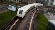 A SkyTrain commuter train travels into downtown Vancouver on April 11, 2012. (Darryl Dyck for The Globe and Mail)