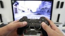 A person plays a video game at a Sony Playstation in the Sony's flagship store in Berlin, April 27, 2011. (Thomas Peter/REUTERS)