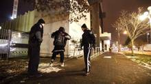 """Victoria police make their rounds on the downtown streets of Victoria known as """"Ground Zero"""" for the homeless and drug addicts in an image from Nov. 24, 2010. (Deddeda Stemler For The Globe and Mail)"""