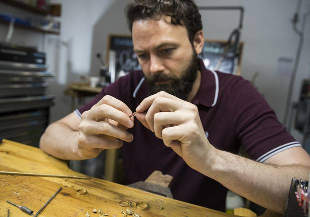 Ryan Taylor, co-founder of Fair Trade Jewellery Co., with jewellery made of