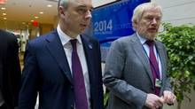 Russian Finance Minister Anton Siluanov, left, and Russian Deputy Finance Minister Sergei Storchak walk to the G20 finance ministers and central bank governors meeting on the sidelines of their meeting at World Bank Group-International Monetary Fund Spring Meetings, Friday, April 11, 2014, in Washington. (Jose Luis Magana/AP)