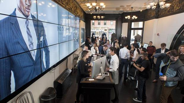 "The 'virtual' mens' clothing firm Indochino created a store in Washington D.C. for a few days in early March of 2013 in the thriving downtown district. Here, customers and stylists fill the lobby of the temporary space where the ""traveling tailor"" is operating. Most of the clients were there by appointments made online. (Thomas Graves/Thomas Graves)"