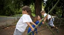 Jill Amery plays with her sons Ford, 6, and Hudson, 4, at the Cypress Park School playground in West Vancouver, B.C. on Aug. 29, 2012. (Rafal Gerszak for The Globe and Mail)