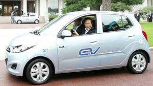 South Korean President Lee Myung-Bak (C) drives Hyundai's BlueOn, during an unveiling ceremony in Seoul in September, 2010. Designed to tap into the increasingly competitive electric auto market, the BlueOn is Hyundai's first full-speed electric car.