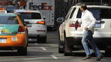 Busy morning traffic on Yonge St. in downtown Toronto. (File photo) (Fred Lum/The Globe and Mail)
