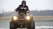 Tory Leader Stephen Harper rides an ATV during a camapign stop on a farm in Wainfleet, Ont., on April 4, 2011. (SEAN KILPATRICK/THE CANADIAN PRESS)
