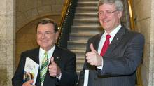 Finance Minister Jim Flaherty and Prime Minister Stephen Harper make their way to the House of Commons to deliver the budget speech, Monday June 6,2011 in Ottawa. (THE CANADIAN PRESS/Fred Chartrand/THE CANADIAN PRESS/Fred Chartrand)