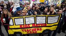 Striking British Columbia teachers and other supporters hold a rally in Vancouver on the final day of a three-day province-wide walkout, on March 7, 2012. (DARRYL DYCK/Darryl Dyck/The Canadian Press)