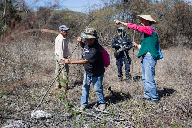 Family members search the mountains near Huitzuco.