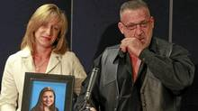 Mike and Rachael Szendrei, parents of Laura Szendrei, who was murdered in Mackie Park in Delta on Sept. 25, 2010, hold a photo of her during a press conference in Delta in October 2010. (Jeff Vinnick/The Globe and Mail)