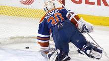 Edmonton Oilers goalie Ben Scrivens is scored on by the New York Rangers during second period NHL hockey action in Edmonton, Alta., on Sunday March 30, 2014. (The Canadian Press)