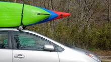 Three kayaks secured atop a Toyota Prius. (iStockphoto)