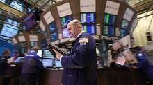 Traders work on the floor of the New York Stock Exchange, April 9, 2012. (BRENDAN MCDERMID/Brendan McDermid/Reuters)