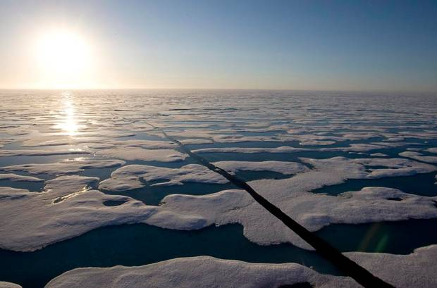 The midnight sun shines over the ice covered waters near Resolute bay at 1:30am as seen from the Canadian Coast Guard icebreaker Louis S. St-Laurent Saturday, July 12, 2008.