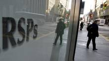 Banks advertise retirement savings plans in downtown Toronto. (Peter Power/Peter Power/The Globe and Mail)