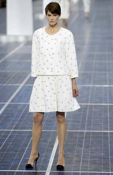 After mining the sea and the earth's geologic core for inspiration the previous two seasons, Karl Lagerfeld turned to air for his Spring 2013 collection. Within the Grand Palais, giant wind turbines and a runway that resembled solar panels set the stage for a look that felt coastal and cool. (Reuters)