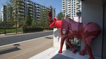 A life-size moose stands in front of the Canadian residence in the athletes' village at the 2012 London Olympics (Jason Ransom/The Canadian Press)