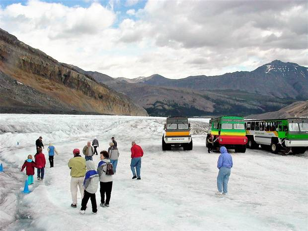 Ice Explorer vehicles parked on the Athabasca Glacier.