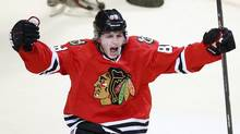 Chicago Blackhawks' Patrick Kane celebrates his goal against the Calgary Flames during the first period of their NHL hockey game in Chicago, Illinois, April 26, 2013. (Reuters)
