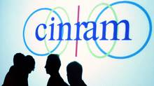 Cinram shareholders are silhouetted against projector screen during shareholders meeting in Toronto (J.P. MOCZULSKI/REUTERS)