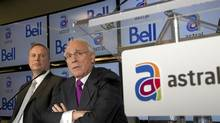 Bell Canada Enterprises chief executive officer George Cope, left, and Ian Greenberg, CEO of Astral Media Inc., speak at a news conference to announce their merger deal. (CHRISTINNE MUSCHI/CHRISTINNE MUSCHI/REUTERS)