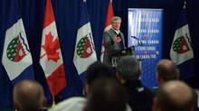 Prime Minister Stephen Harper makes an announcement on an all-weather road linking Canada's Arctic coast to the south for the first time, in Inuvik, Northwest Territories, Wednesday, Jan.8, 2014. (Jonathan Hayward/THE CANADIAN PRESS)