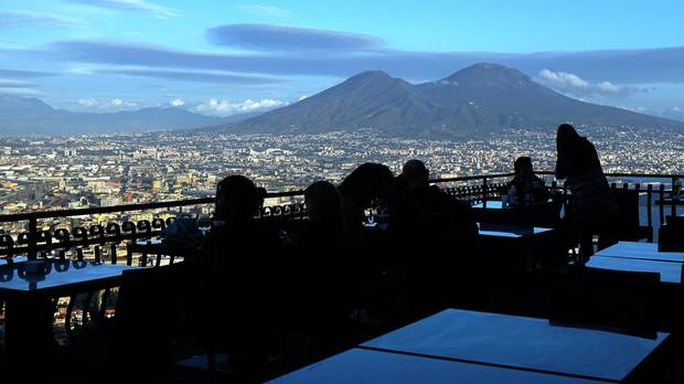 A terrace overlooks the Bay of Naples and Mount Vesuvius. Although Naples may not be the prettiest of cities, it is geographically positioned lends it a certain glamour.