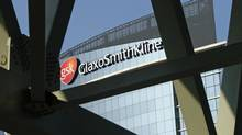 A sign for British pharmaceuticals company GlaxoSmithKline is seen on its London offices. Sales in the final quarter of 2012 fell 3 per cent, mostly due to the economic downturn in Europe. (SANG TAN/The Associated Press)