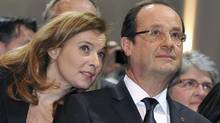 Valerie Trierweiler and French President François Hollande attend the inauguration of the Auzelou community hall in Tulle, central France in this January 19, 2013 file photo. (Reuters)
