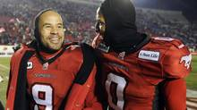 Stampeders' Jon Cornish smiles after Calgary's win over the Saskatchewan Roughriders in the CFL West Division semi-final football game in Calgary, Alberta, November 11, 2012. (STRINGER/CANADA/REUTERS)