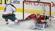 Minnesota Wild' Mikko Koivu (L) scores on Calgary Flames' goalie Leland Irving during an overtime shoot out in their NHL game in Calgary, Alberta, February 11, 2013. (TODD KOROL/REUTERS)