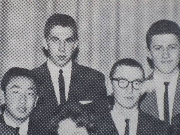 Mr. Brylla is shown second from left in a Grade 11 high-school yearbook photo.