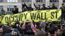 Occupy Wall Street protesters rally in a small park on Canal Street in New York, Nov. 15, 2011. (Seth Wenig/AP)