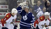 Toronto Maple Leafs goalie Jonas Gustavsson adjusts his mask after allowing a goal to Florida Panthers forward Tomas Kopecky (R) during the second period of their NHL hockey game in Toronto November 8, 2011. (MIKE CASSESE/REUTERS)
