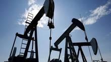 Pump jacks at work pumping crude oil near Halkirk, Alta. on June 20, 2007. (LARRY MACDOUGAL/THE CANADIAN PRESS)