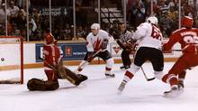 Mario Lemieux scores the winning goal against the Soviet Union in the 1987 Canada Cup. (Scott Macdonald/CP)
