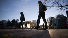 Students walk between buildings on UBC campus in Vancouver, B.C., on October 29, 2013. (Ben Nelms for The Globe and Mail)