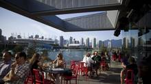 A humming patio, this one at The Original Tap & Barrel restaurant and bar in the Olympic Village–now common in a neighbourhood that was once barren. (Rafal Gerszak for the Globe and Mail/Rafal Gerszak)