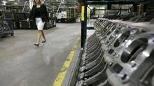 Linda Hassenfratz, CEO of Linamar, tours the auto-parts firm's Vehcom Manufacturing facility, which produces gears for big three auto makers, in Guelph, April 5, 2005. (J.P. Moczulski//Globe & Mail)