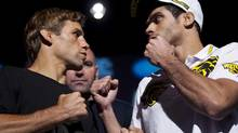 Ultimate Fighting Championship fighter Renan Barao, right, from Brazil, and Urijah Faber, from Sacramento, Calif., attend a news conference in Calgary, Alta., Thursday, July 19, 2012. UFC 149 takes place in Calgary, on Sat., July 21. (Jeff McIntosh/THE CANADIAN PRESS)