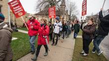 Stratford Central Secondary School students march alongside Elementary teachers from the Avon Mainland School Board in front of the school in Stratford, Ontario, December 10, 2012 on the first day of rotating 1 day strikes by elementary teachers in Ontario to protest the government's imposed contract. (GEOFF ROBINS for The Globe and Mail)