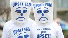 Toronto Maple Leafs fans wear bags over their heads. (Fernando Morales/The Globe and Mail)