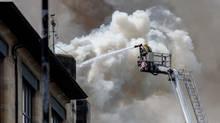 Firefighters attack the blaze last week at the Glasgow School of Art. (David Barz/AP)