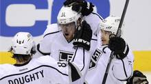 Los Angeles Kings center Anze Kopitar (C) celebrates his 1st period goal against the Phoenix Coyotes with teammates Drew Doughty (8) and Dustin Brown (23) during Game 5 o